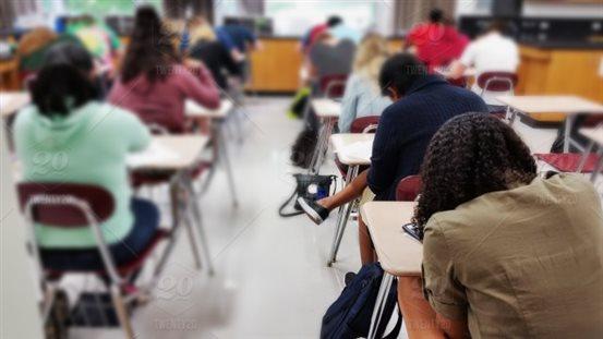 stock-photo-school-classroom-class-high-school-desks-test-students-back-to-school-testing-6cb79bf9-60b5-4f85-b009-476ec21ca186